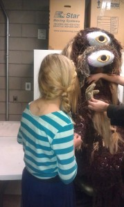 Lizzie gets up close and personal with Aunt Beast's costume.